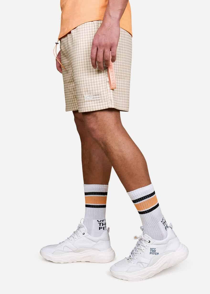 Sand Pea the Poeh shorts OTP - zandkleurig joggingsbroekje met pied de poule print en oranje kleur